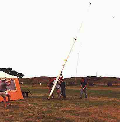"Setting up the pole to hold the inverted ""V"" antennas for 80m & 40m bands"